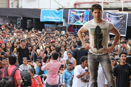 crowd cheers as Varun Dhawan motivates them
